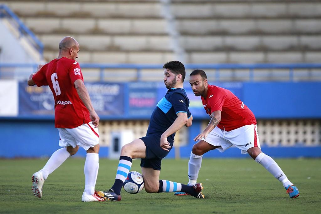 Un lance del partido disputado esta tarde entre el Ciudad de Ibiza y el CD Ibiza.